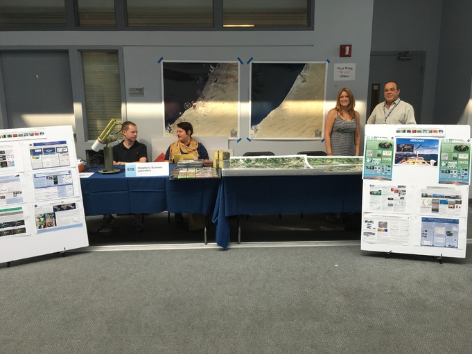 Biospheric Sciences lab 2016 Science Jamboree showing science posters, Landsat before and after land use change and a sun photometer from the AERONET group.