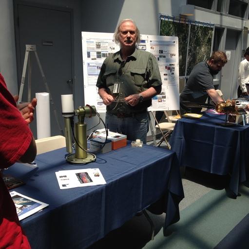 Biospheric Sciences Laboratory Scientist explaining the use of the sun-photometer instrument in measuring atmospheric aerosols.