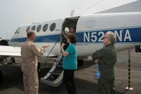 LVIS team members Bryan Blair (GSFC), Michelle Hofton (UMD) and David Rabine (GSFC) with Lead Pilot Richard Yasky in front of the LaRC B-200 airplane.