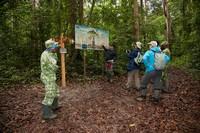 AfriSAR Rainforest Team and ANPN (Agence Nationale des Parcs Nationaux du Gabon) looking at the entrance signs at the Raponda Walker. Arboretum/Mondah Forest.