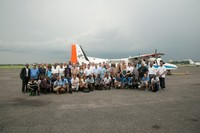 Group photo of NASA, AGEOS and DLR teams in front of the DLR Dornier aircraft on Media Day.