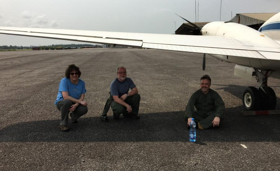 Michelle Hofton, Bryan Blair and David Rabine from the LVIS team cooling off under the B-200 wing.