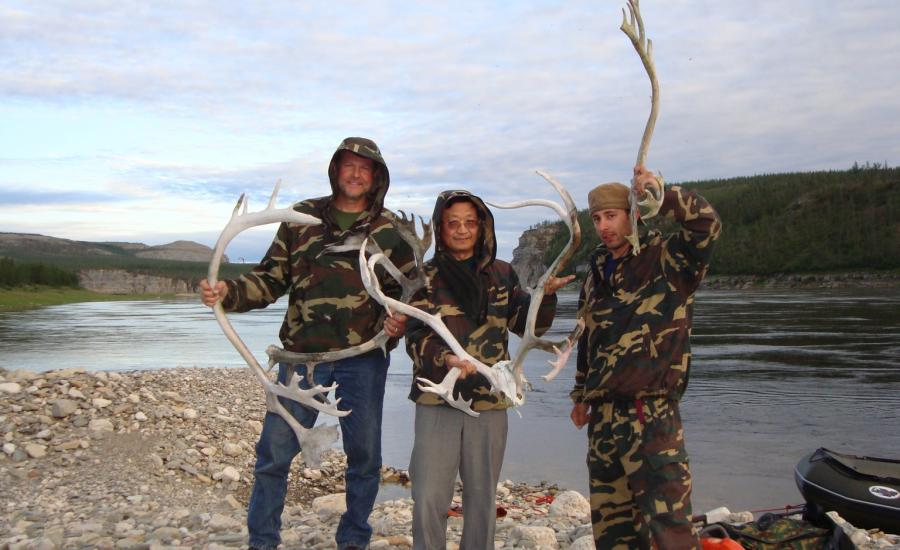 Members of the 2008 Siberian Forest Expedition (Ross Nelson, Guoqing Sun, and Paul Montesano) pose with reindeer antleers discovered along the Kotuykan River.