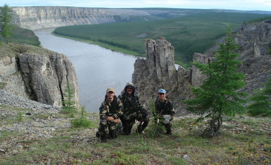 The view to the east as Paul Montesano, Jon, Ranson, and Guoqing Sun take a knee on the cliffs overlooking the confluence of the Kotuykan and Kotuy Rivers