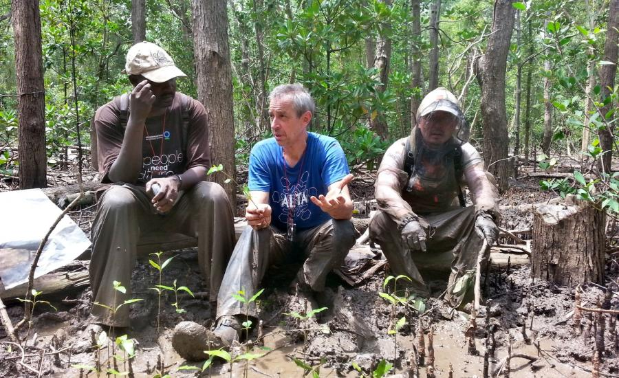 Discussing the issues of sampling in the illegally cut areas. Left to right: Drs. Mwita Mangora (University of Dar Es Salaam), Carl Trettin (USFS), and SeungKuk Lee (NASA/GSFC)